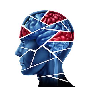 Kognitive forstyrrelser er illustreret ved at opdele et menneskehovede og hjerne. Kognitiv adfærdsterapi kan hjælpe de beskadigede dele i hjernen
